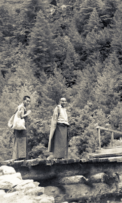 Lama Yeshe and Lama Zopa Rinpoche on the road to Lawudo Retreat Centre, Nepal, 1973.