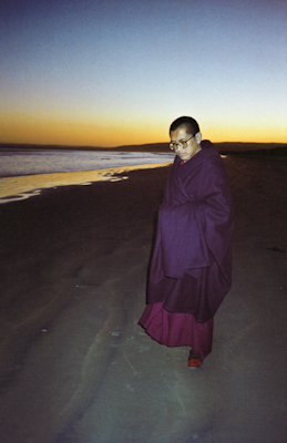Lama Zopa Rinpoche on the beach in Adelaide, Australia, 1983. Photo: Wendy Finster.