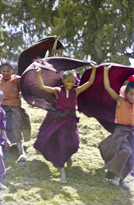 "The little monks of Mount Everest Centre ""flying"" with their robes in the wind, Kopan Monastery, Nepal, 1973."