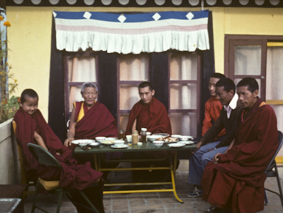 Yangsi Rinpoche, Geshe Legden and Lama Zopa Rinpoche, with Lama Lhundrup at the right, on the rooftop terrace, Kopan Monastery, Nepal, 1976.