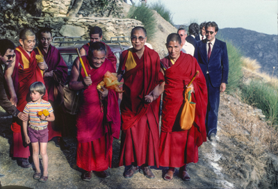 Lama Yeshe with His Holiness the Dalai Lama and entourage arriving at O Sel Ling Retreat Center, Spain, in September, 1982.
