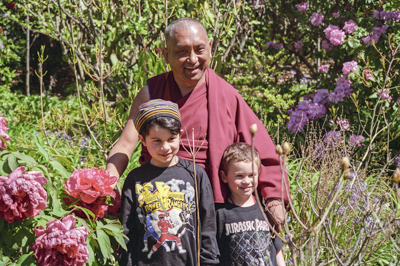 Lama Zopa Rinpoche with children at Chenrezig Institute, Australia, 1994.