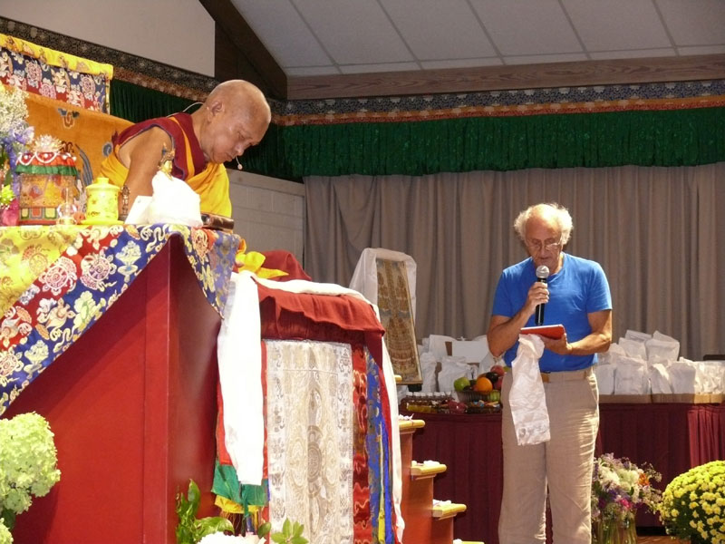 Nick Ribush delivering a request for Lama Zopa Rinpoche's long life at Light of the Path retreat 2016. Photo: Kalleen Mortensen.