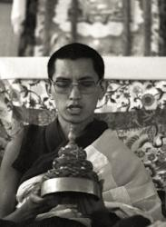 Lama Zopa Rinpoche offering a mandala at the Ninth Meditation Course, Kopan Monastery, Nepal, 1976.