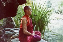 Lama Yeshe meditating in the botanical gardens, Berkeley, California, 1974. Photo donated by Judy Weitzner.