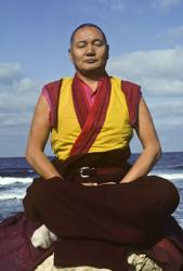 Lama Yeshe meditating by the ocean, Sicily, 1983. Photo: Jacie Keeley.