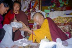 Lama Zopa Rinpoche receiving a mandala offering, 1990. Photo: Merry Colony.