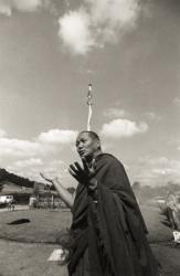 Lama Yeshe at an outdoor puja  to celebrate the end of the first year of a geshe studies course, Manjushri Institute, England, 1979.