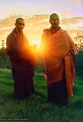 (15124_pr.psd) Lama Zopa Rinpoche and Lama Yeshe at dawn, Chenrezig Institute, Australia, 1975. Photo by Nick Ribush, taken on Saka Dawa at Chenrezig Institute, Australia, 1975. Restoration by David Zinn. Archival portrait available through Heart of the Moon Media (www.heartofthemoon.com).