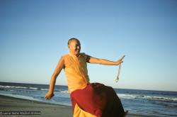 (15925_sl.tif) Lama Yeshe dancing/debating on the beach after the month-long course at Chenrezig Institute, Australia, 1975. Photo by Anila Ann.