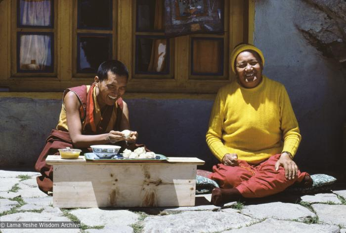 Lama Yeshe and Lama Zopa Rinpoche in front of the cave of the Lawudo Lama, Lawudo Retreat Centre, 1981. Photo by Peter Kedge.